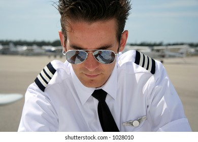 Pilot studying chart - notice reflection in glasses