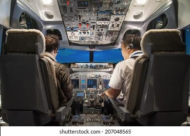 Pilot teach trainee pilot to operate the panel