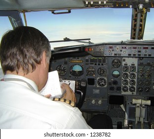 Pilot in a uniform operating 737 Boeing - inside cockpit