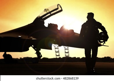 Pilot walking away after a mission at sunset