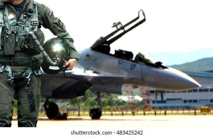 Pilot walking away from aircraft after a mission