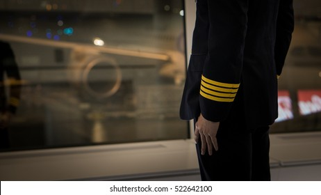 pilot wear four golden strips jacket in airport terminal