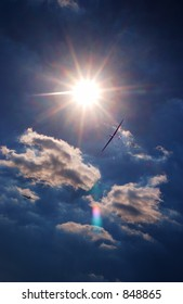 Piloted gliders fly in a sunny summer sky