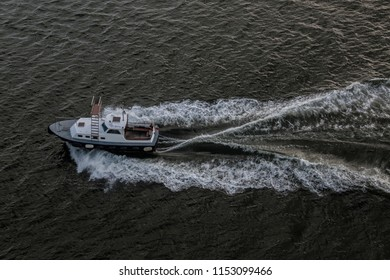 Piloting boat going out of port