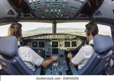 Pilots in an airplane cockpit