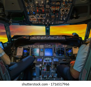 Pilots Airplane interior view Cockpit Flight Deck passenger Aircraft sunset windows background