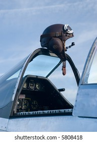 A pilot's leather flying helmet atop a P-51 Mustang fighter plane