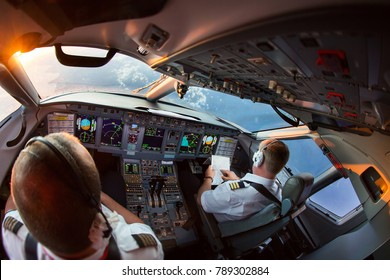The pilots of the passenger plane at work. View from the aircraft cockpit.