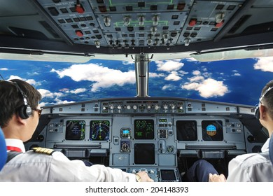 Pilots in the plane cockpit and cloudy sky