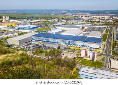 PILSEN, CZECH REPUBLIC - APRIL 19, 2018: Flight over modern storage warehouse with solar panels on the roof. Industrial zone and technology park on Bory suburb of Pilsen city, Czech Republic, Europe.