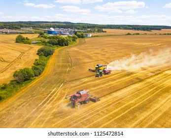 PILSEN, CZECH REPUBLIC - JULY 1, 2018: Aerial view of summer harvest. Combine harvesters and tractor harvesting wheat field. Agriculture from drone view.