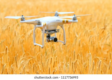 PILSEN / CZECH REPUBLIC - JUNE 20, 2018: Drone quadrocopter Dji Phantom 3 Professional with camera. Farmer use drone for inspect of crop on wheat fields. Modern technology in agriculture.