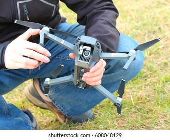 PILSEN CZECH REPUBLIC - MARCH 24, 2017: Unidentified young engineer tightening propeller of Dji Mavic Pro with 4K high resolution camera. A quadrocopter is powerful photografic tool for traveling.