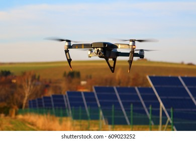 PILSEN, CZECH REPUBLIC - MARCH 25, 2017: DJI Mavic Pro drone in the flight. Engineers use Mavic for inspect solar panels from above. Modern technology in photovoltaic power plant industry.