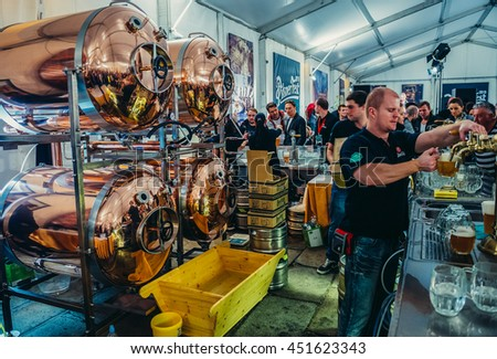Pilsen, Czech Republic - October 3, 2015. Bartender pours beer during Pilsen Fest in tent located in Pilsner Urquell Brewery area