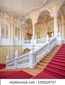 PILSRUNDALE, LATVIA, March 24, 2019: Interior of Rundale palace - central staircase with red carpet.