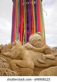 Pilton, UK - 25 June, 2017: A sand sculpture of Jeremy Corbyn riding a fox while chasing Theresa May, from Glastonbury music festival
