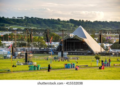 PILTON, UNITED KINGDOM - JUNE 23, 2015 : A view of the Pyramid stage as people arrive at the Glastonbury festival 2015.