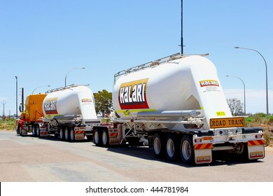 PIMBA, AUSTRALIA - November 29. Commercial transport by Kalari road train at a truck stop on the Stuart Highway on November 29, 2015 in Pimba. Industrial transportation for the mining industry.