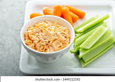 Pimento cheese with celery and carrot sticks