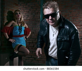 pimp and a prostitute in back alley