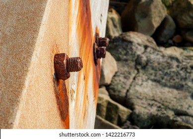 Pin and bolt rusted from salt water, taken on the bridge of the Massa Lubrense seafront, near Sorrento