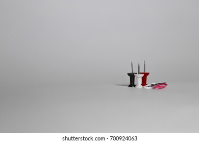 Pin buttons and paper clips on a white background