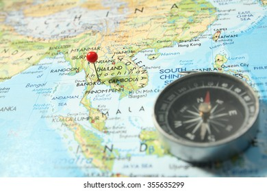 Pin and compass on map with focus on Bangkok capital, Thailand