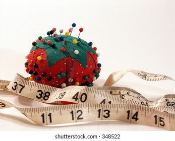 pin cushion and tape measure