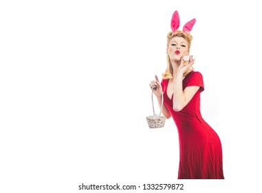 Pin up Easter. Lovely woman in rabbit costume. Happy woman preparing for Easter. Pinup woman in bunny ears with Easter egg. Pretty girl hunts for Easter eggs