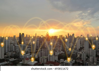 pin flat above cityscape, sunset and glowing orange networking connection as communication concept