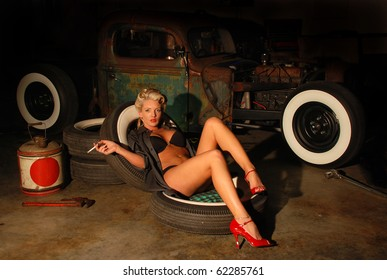 Pin Up Girl in Garage with a Classic Truck