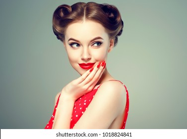 Pin up girl vintage. Wow expressions emotion! Beautiful woman pinup style portrait in retro dress and makeup, manicure nails hands, red lipstick and polka dot dress, surprised face.