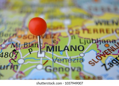 Pin marked city of Milano on map with red pin, Italy
