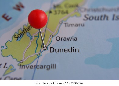 Pin marked Dunedin on map with red pin, New Zealand