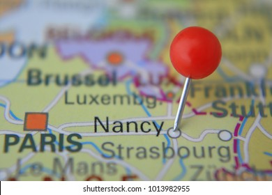 Pin marked Nancy on map with red pin, France