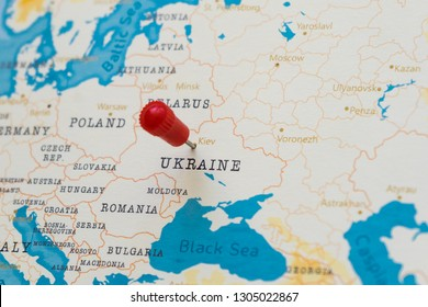 a pin on kiev, ukraine in the world map