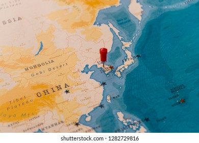 a pin on seoul, south korea in the world map