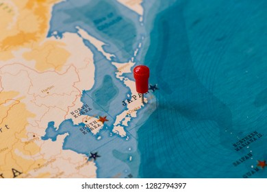 a pin on tokyo, japan in the world map
