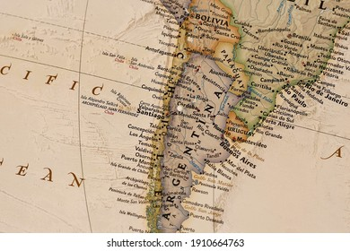 Pin in paper map of South America. Macro shot of paper map with destination. Travelers map.