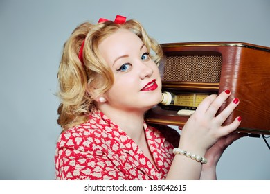 pin up plus size blonde girl posing with old fashioned radio