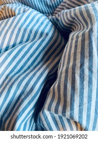 Pin striped bed linen in use