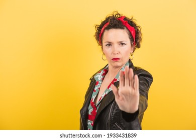 a pin up woman makes a stop gesture with her hand