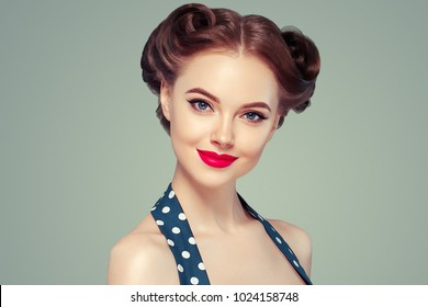 Pin up woman portrait. Beautiful retro female in polka dot dress with red lips  and old fshion hairstyle