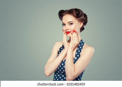 Pin up woman portrait. Beautiful retro female in polka dot dress with red lips and manicure nails and old fshion hairstyle