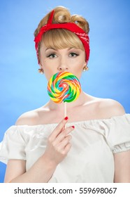 Pin up woman with spiral lollipop