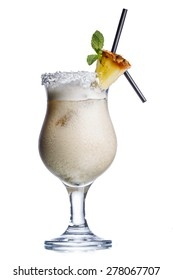 Pina colada alcoholic cocktail decorated with pineapple slice and two black straws
