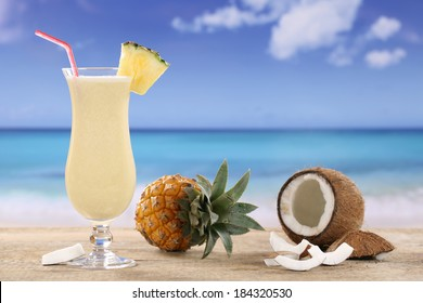 Pina Colada cocktail with fruits on the beach while on vacation