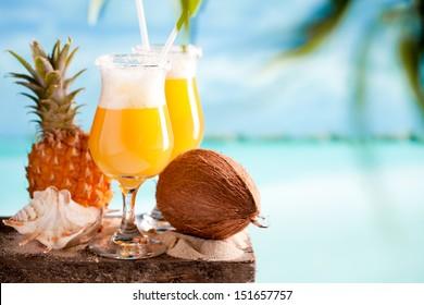 Pina colada drink on blue beach background