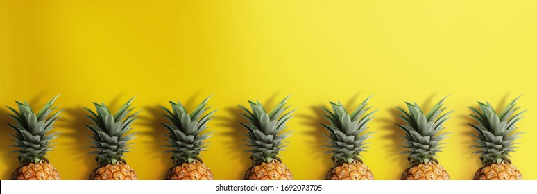 Pinapple on pastel yellow background. Tropical fruits concept.